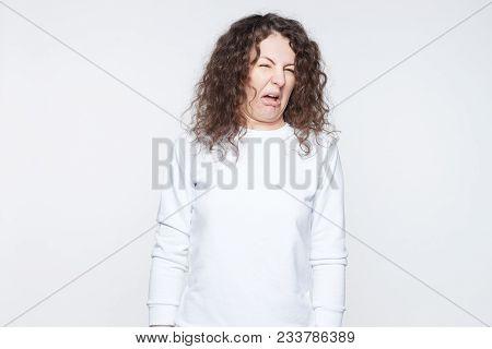Brunette Woman In Casual Clothes Expressing Disgust, Unwillingness, Dislike, Disregard Having Tensiv