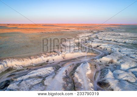 dusk over Main Draw OHV Area in Pawnee National Grasslland in northern Colorado, fall or winter scenery, aerial view