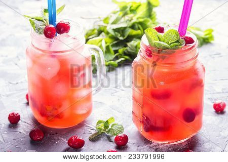 Berry Cocktail Of Red Currant And Cowberry With Ice And Fresh Mint Leaves, With Powdered Sugar In Co