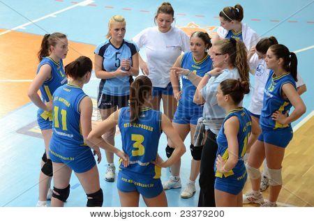 KAPOSVAR, HUNGARY - APRIL 24: Kaposvar players listening to their trainer at the Hungarian NB I. League woman volleyball game Kaposvar (blue) vs Ujbuda (black), April 24, 2011 in Kaposvar, Hungary.