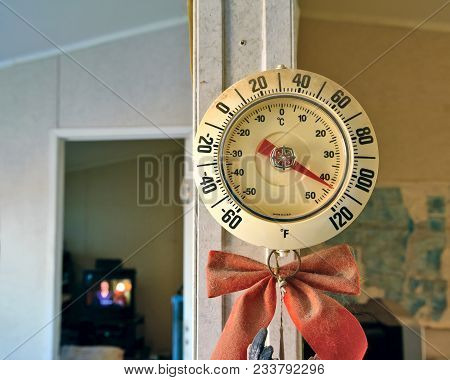 A Thermometer Inside The Living Room Of An Arizona Home Showing The Interior Of The Home Baking At 1