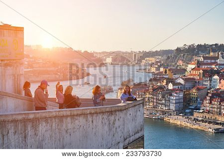 Porto, Portugal - February 20, 2018: Observation Deck. Tourists Taking Pictures And Admiring Of Old
