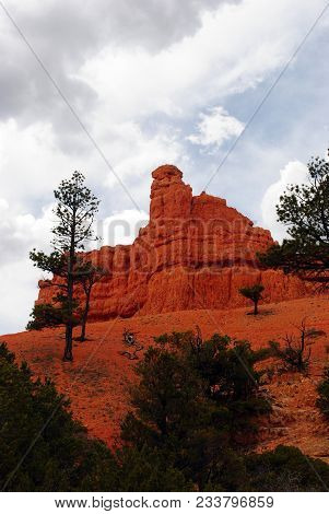 Red Rocks Of Utah And Bryce Canyon With Cloudy Sky.