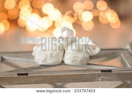Small Litie Baby Booties In Female Hands