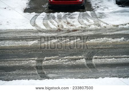 Car Tire Track On Snow In The Street