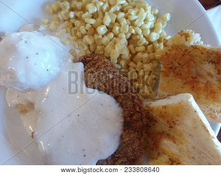 Chicken Fried Steak with Mashed Potatoes, Corn and Country Gravy