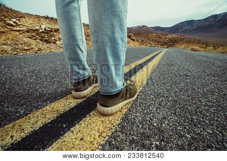 Man Ready To Take A New Way And Make A Step To New Life Concept. Feet On Empty And Free Asphalt Road