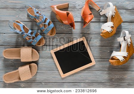 Set Of Womens Shoes (wedges, Heels And Flat Sandals) On Grey Wooden Background. Spring Summer Collec
