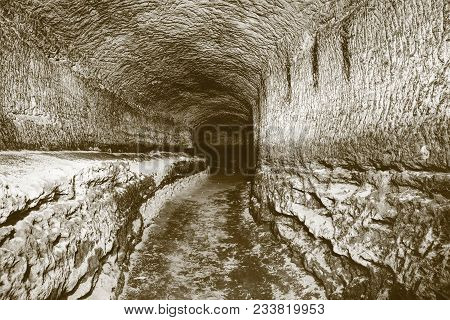 The Old Sandstone Water Tunnel, Mined Caves.  The Cave. Sandstone Tunnel Moistened Walls. Dry Channe