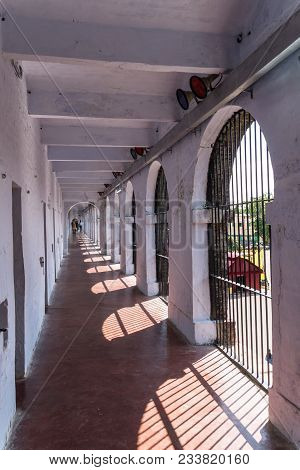 Corridor In A Wing Jail, Andaman And Nicobar Islands, India. Solitary Confinement Cells Along The Wh