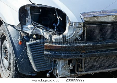Gray Car After An Accident With A Broken Lamp And A Bumper