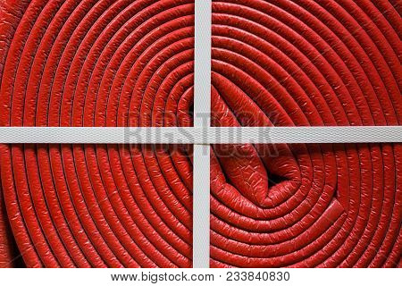 Close Up Red Plastic Pipe Is As Part Cable Coil  And Is Used For Protective Electric Cables And Tube
