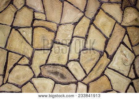Bright And Unusual Stone Background. Decor Wall From Natural Sandstone.