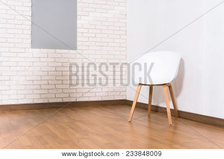 Living Room In A Minimalist Style. Parquet And Brick Walls