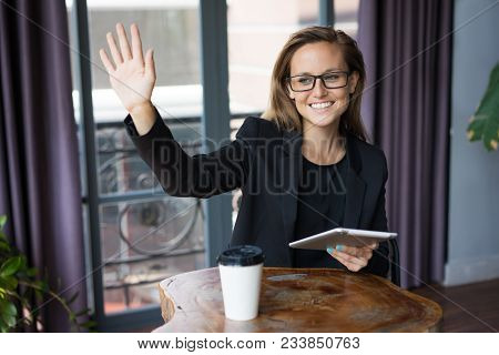 Closeup Portrait Of Smiling Young Beautiful Business Woman Waving Her Hand And Greeting Someone, Hol