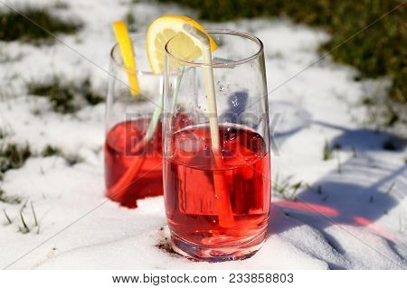 A Strawberry Juice In Small Glass On The Snow Hill For Chilling And Ready For Drunk. Add Lemon For D