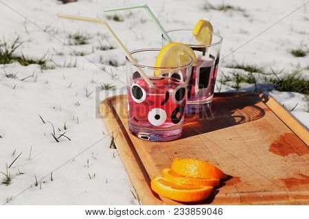 A Design Wooden Board With Many Drinks In The Middle Of Snow