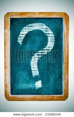 a question mark drawn in an old fashioned blackboard