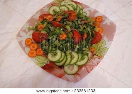Beautiful Fresh Spring Salad From Lettuce, Crust Young Carrot, Cucumber, Red Ripe Tomato Under Lemon