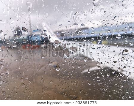 On A Rainy Day Windows Of The Aircraft Were Filled With Rain And Blurred Aircraft In The Aircraft Pa