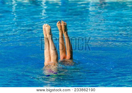 Aquatic Swimmers Doing Synchronized Swimming Pool Dance Moves Closeup Underwater Action Photo Of Uni