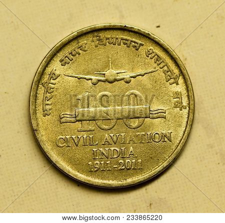 Closeup of Indian currency coin commemorating the 100 years of Civil Aviation in India in 2011 (period 1911 to 2011)