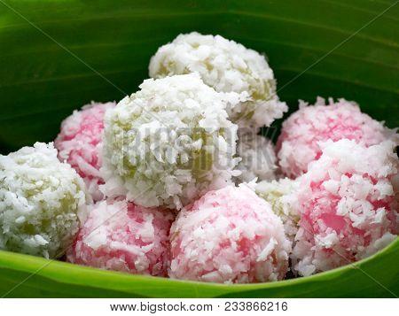 Kanom Ko Or Sugar Dumplings With Coconut In Banana Leave Vessel. South Of Thai Traditional Dessert.