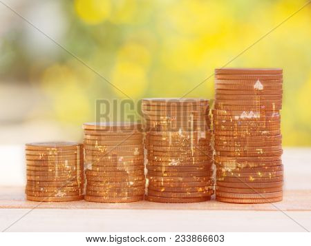 Double Exposure Of City And Coin Stack For Business Finance And Banking Concept. Golden Color Coin S
