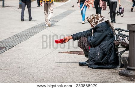 Hungry Homeless Beggar Woman Beg For Money On The Urban Street In The City From People Walking By, S