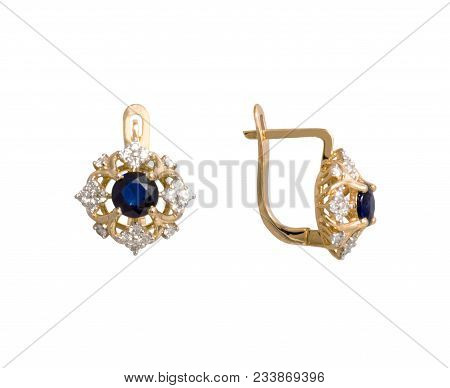Golden earrings with dark blue gem - sapphire and few diamonds isolated on white background poster