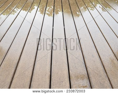 Texture Of Vintage Lath Wood Plank Panel Floor Wet From Rain With Reflection Of Tree.
