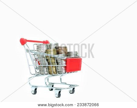 Shopping Trolley With Coins Isolated On White Background. Concept Of Save Money, Cash Back When Shop