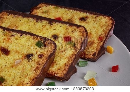 Fruitcake And Small Pieces Candied Fruits