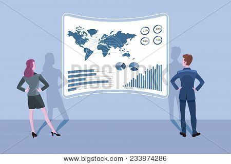 Business Man And Business Woman Standing In Front Of A Big Interface Screen. They Are Anayzing The D