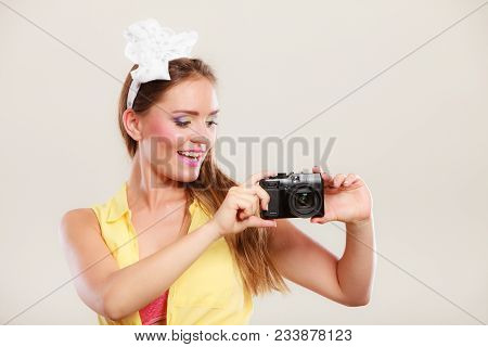 Happy Smiling Pretty Pin Up Girl With Hairband Bow Taking Photo Picture With Camera. Attractive Gorg