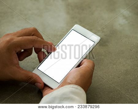 Man Holding Phone Left Hand Using Smartphone Pointing Finger On White Screen On Top View.