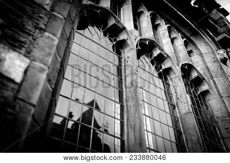 Historic Gothic Leaded And Decorative Arched Windows In An Ancient Church Demonstrating Tradional Me