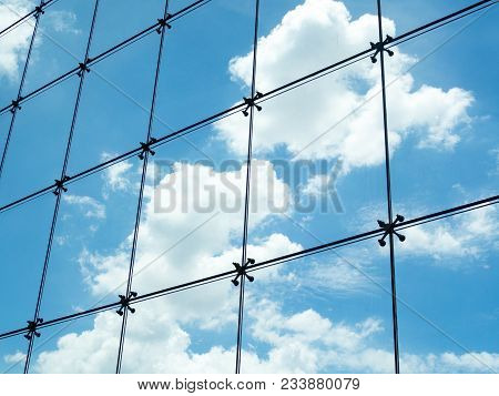 Seamless Steel Mesh Wire On Glass Wall Against With Blue Sky And White Cloud Outside Skyscrapers Bui