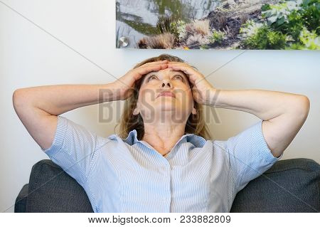 Elderly Woman Suffering From Headache Migraine Pain At Home. Health Problem, Stress And Depression.