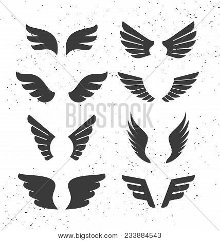 Set Of Monochrome Open Wings For Badges And Signs. Vector Symbolic Black Wings Isolated On White. Si