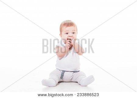 Baby Teething, Boy Sucks His Hands Isolated On White