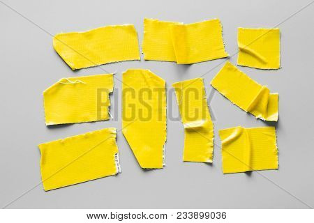 Set Of Yellow Tapes On Gray Background. Torn Horizontal And Different Size Black Sticky Tape, Adhesi