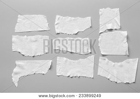 Set Of White Tapes On Gray Background. Torn Horizontal And Different Size Black Sticky Tape, Adhesiv