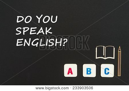Abc Letters And Chipboard Miniature Book And Pen On Blackboard With Text Do You Speak English. Conce