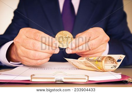 The Boss Decides On Investing In The Ico. On The Desk There Is A White Paper And Cash Euros.