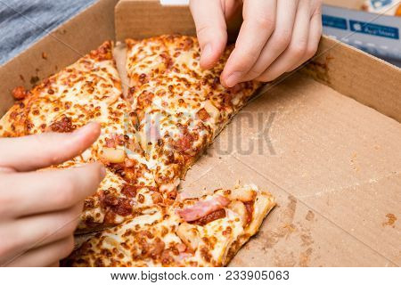 Horizontal Close Up Image Of A Meat And Cheese Pizza In A Cardboard Pizza Box With Copy Space.