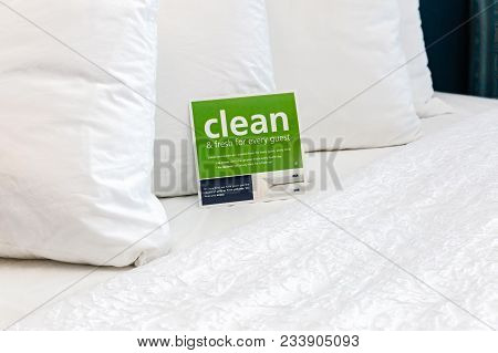 Horizontal Close Up Image Of Soft White Fluffy Pillows On A Bed At A Hotel.