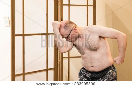 Horizontal Image Of A Caucasian Older Mature Man Flexing His Muscles And Kissing His Bicep To Be  Si