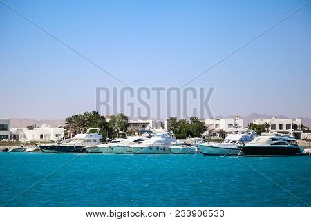 Yacht Parking In Harbor, Harbor Yacht Club. Beautiful Yachts In Blue Sky Background