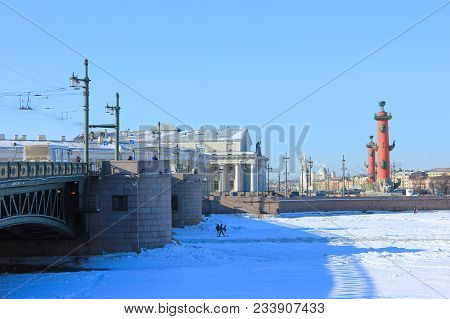 St. Petersburg Winter Scene With Rostral Columns Architecture And Snow Covered Neva River From Palac